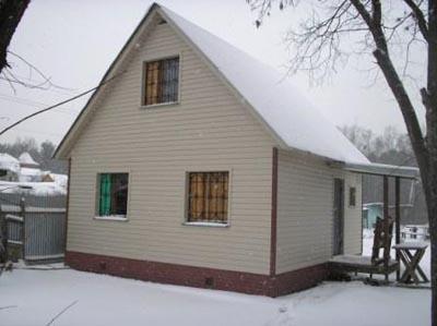Отделка фасада деревянного дома сайдинг